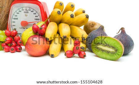 ripe fruit and kitchen scales on a white background. horizontal photo. - stock photo