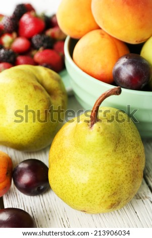 Ripe fruits and berries on table close up