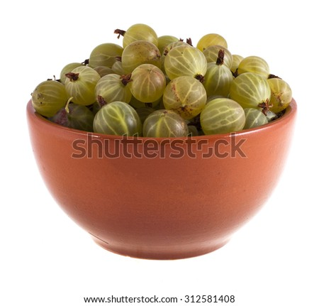 Ripe gooseberries in a brown bowl isolated on white background - stock photo