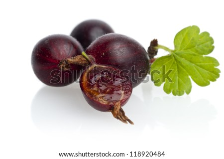 Ripe gooseberry with leaf on white - stock photo
