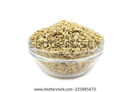 ripe grain oats in a glass on a white background