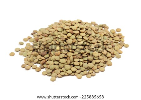 Ripe grains of lentils on a white background