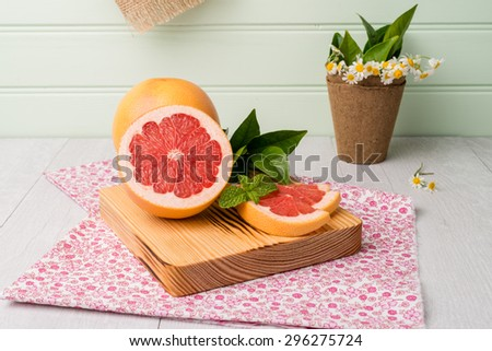 Ripe grapefruit close-up on wooden table background. - stock photo