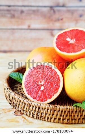 ripe grapefruit sectional, food closeup - stock photo