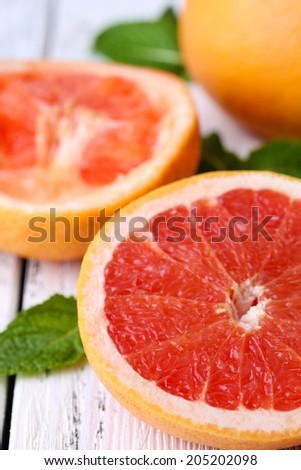 Ripe grapefruits on color wooden background - stock photo