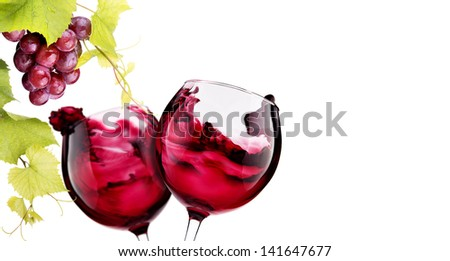 Ripe grapes and  pair of wine glass isolated on white. Love concept