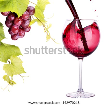 Ripe grapes and  wine glass isolated on white - stock photo