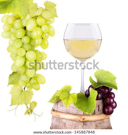 Ripe grapes and wine glass on a wooden vintage barrel isolated on a white background