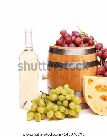 ripe grapes, barrel and bottles of wine