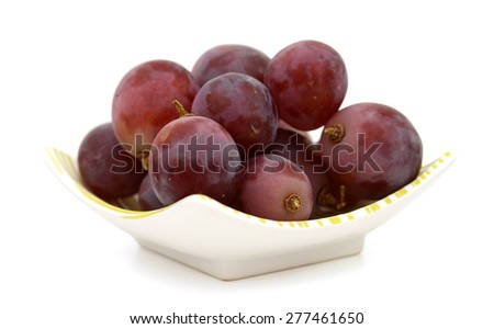 ripe grapes on plate isolated on white  - stock photo
