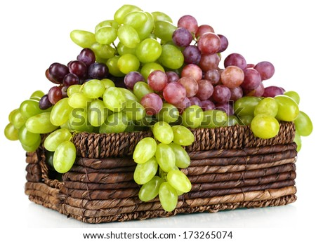 Ripe green and purple grapes in basket isolated on white - stock photo