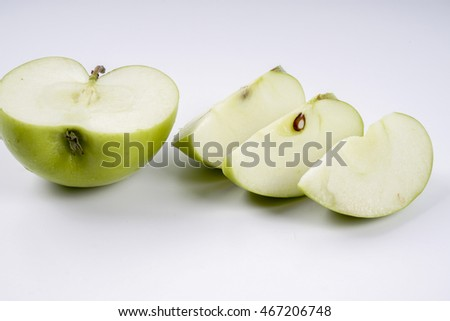 Ripe green apple and slice isolated on a white background with clipping path