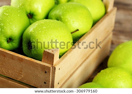 Ripe green apple in crate close up - stock photo
