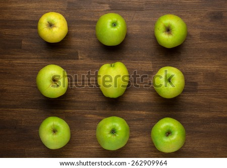 Ripe green apples on wooden background top view  - stock photo