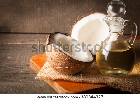 Ripe half cut coconut on a wooden background. Ripe half cut coconut on a wooden background