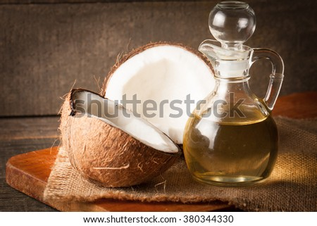 Ripe half cut coconut on a wooden background. Ripe half cut coconut on a wooden background - stock photo