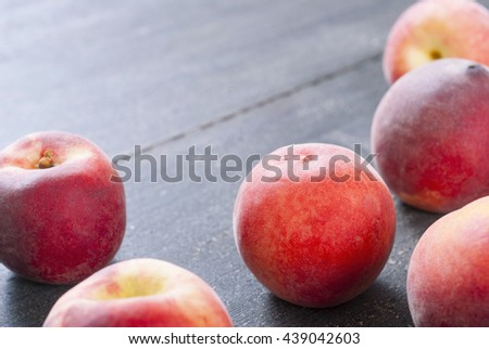 ripe homegrown peaches on black wooden table