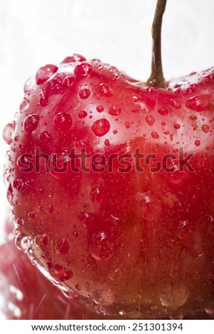 Ripe juicy cherry with water droplets