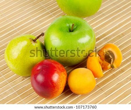 Ripe juicy fruit in a striped straw - stock photo