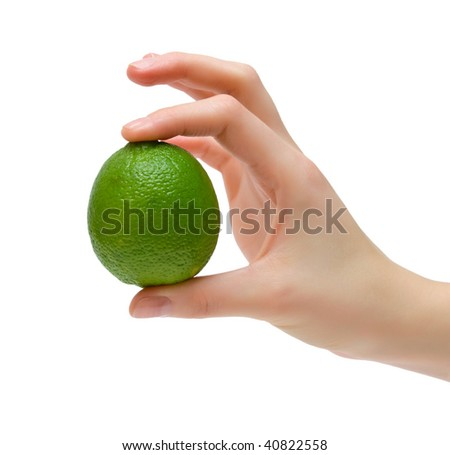 Ripe juicy lime in female hand. Isolation. - stock photo