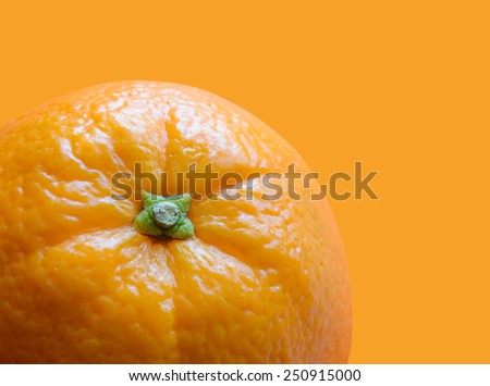 Ripe Juicy Orange Isolated on the Orange Background - stock photo