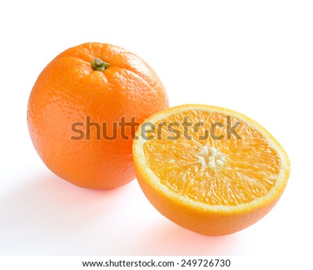 Ripe Juicy Orange with Slice Isolated on the White Background - stock photo
