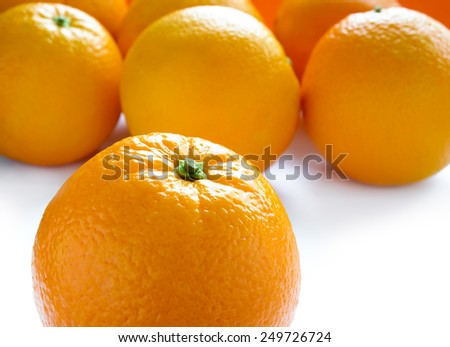 Ripe Juicy Oranges Isolated on the White Background - stock photo