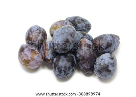 Ripe juicy plums on a white background - stock photo