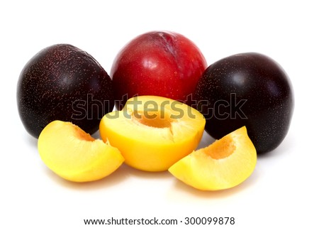 Ripe juicy  red and purple plums isolated on white background - stock photo