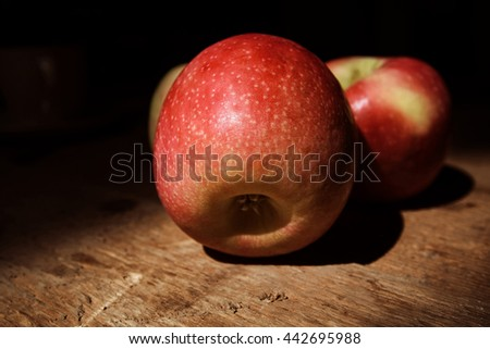 Ripe juicy red and yellow apples on wooden deck - stock photo