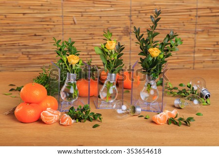 Ripe, juicy tangerines in a beautiful table. Useful fruit, vitamins. Beautiful still life with tangerines. - stock photo