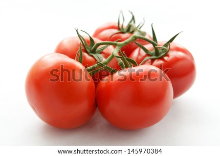 ripe juicy tomatoes on a white background - stock photo