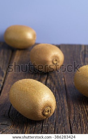 Ripe kiwi fruit on old wooden table. Selective focus