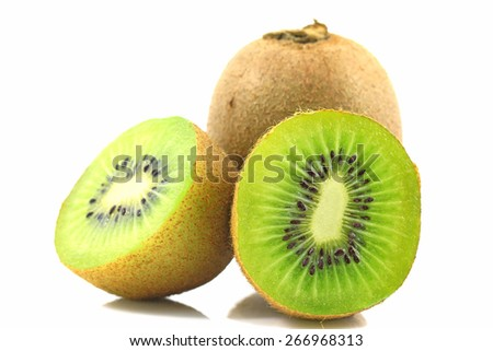 Ripe kiwi fruits with half isolated on white background