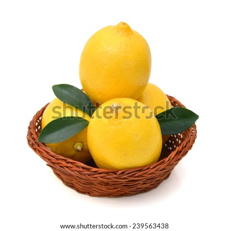 ripe lemons in basket on a white background  - stock photo