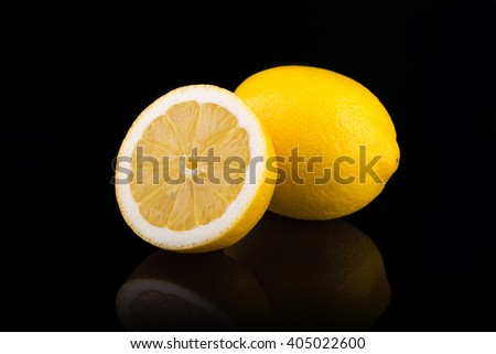 Ripe lemons. Isolated on black background - stock photo