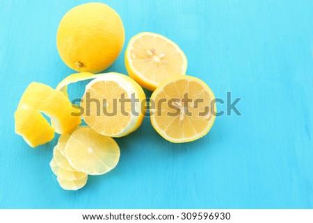 Ripe lemons on wooden table close up - stock photo