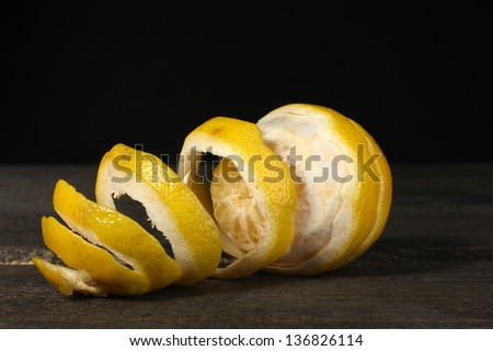 ripe lemons on wooden table on grey background - stock photo