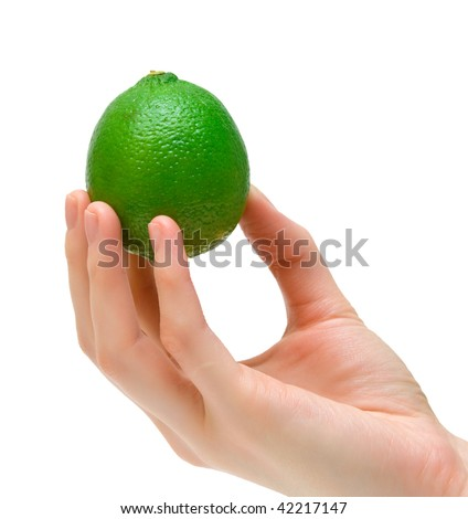 Ripe lime in female hand. Isolation. - stock photo