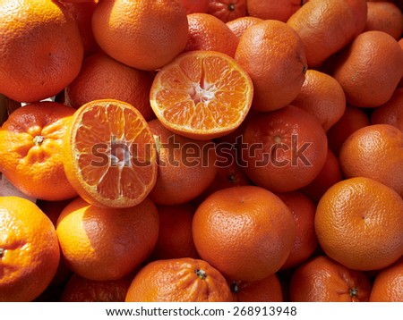 Ripe mandarins clemantins on display in store market     - stock photo