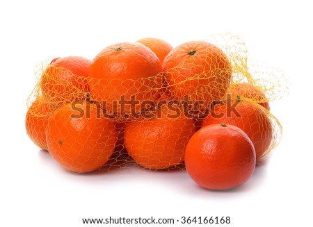 Ripe mandarins in string bag isolated  on white background - stock photo
