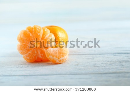 Ripe mandarins on a blue wooden table - stock photo