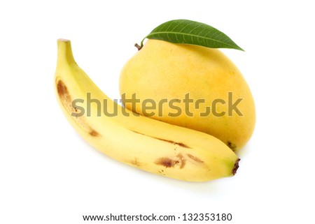 Ripe mango and banana on white - stock photo