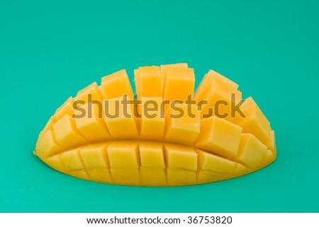 Ripe mango on a green background