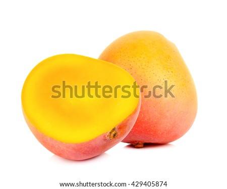 Ripe mango with half isolated on the white background. - stock photo