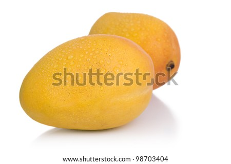 Ripe mangoes isolated on a white background. - stock photo