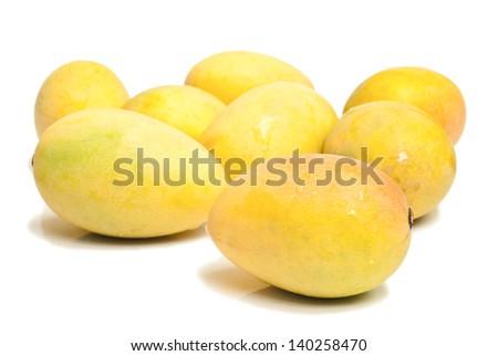 Ripe mangoes on white background - stock photo
