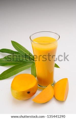 Ripe mangoes on white mangoes on white - stock photo