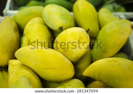 Ripe mangoes sold in the market. - stock photo