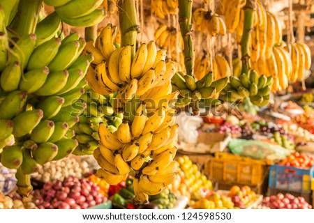 Ripe mangoes stacked at a local fruit and vegetable market in Kenya, Nairobi - stock photo